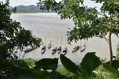 Daily Life of Assam. A distance view of fishing boats on Brahmaputra river in Assam royalty free stock photos