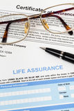 Life assurance application form with pen and glasses Royalty Free Stock Image