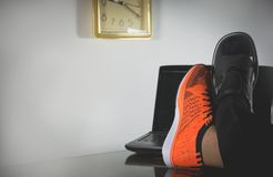 Life balance concept for work and exercise half of business. And sport shoes stock photography