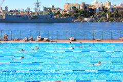 Outdoor swimming pool in harbor at navy docks Royalty Free Stock Image