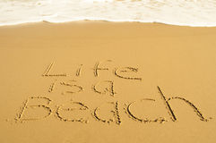 Life is a beach Stock Images