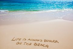 Life on beach. Life is always better on the beach text on white sandy beach and sea stock photo