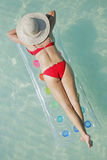 Life is a Beach (Lilo). One of a large series. Woman on a lilo in tropical water Royalty Free Stock Photography