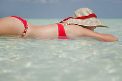 Life is a Beach (Lilo). One of a large series. Woman floating on a lilo in tropical water Stock Photography