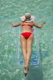 Life is a Beach (Lilo). Woman floating on lilo in tropical lagoon Stock Images