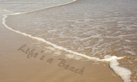 Life is a Beach Written in Sand Stock Images