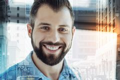 Happy satisfied man having fun and smiling. Life is beautiful. Happy satisfied handsome man having fun looking straight and smiling Royalty Free Stock Photos