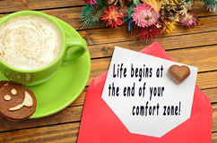 Life begin at the end of your comfort zone. Text on paper Stock Photo