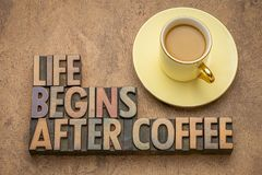 Life begins after coffee. Word abstract in vintage letterpress wood type with a cup of coffee royalty free stock photo