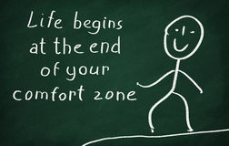 Life begins at the end of your comfort zone. On the blackboard draw character and write Life begins at the end of your comfort zone stock illustration