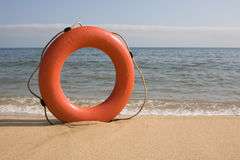 Life belt. On a beach stock photography