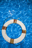 Life Belt. Old Life belt in a blue pool royalty free stock photography