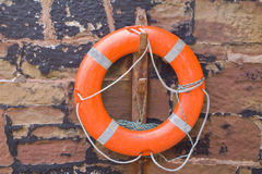 Life belt. A life belt attached to the sea wall royalty free stock photo