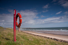 Life belt on a beach. Northumberland, UK stock photo