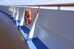Life Belt on Deck. Life Belt hanging on railings on Deck of a Ship Stock Image