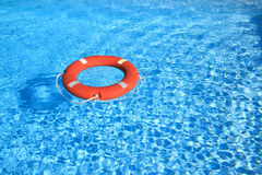 Life belt floating on water. Copy space to add your own text royalty free stock photo
