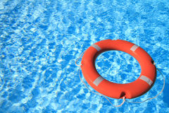 Life belt floating on water Stock Image