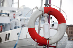 Life belt, passenger ship in the background Royalty Free Stock Image