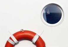 Life belt and porthole. Window with reflection on ship royalty free stock image