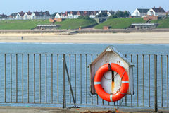 Life belt or preserver by the ocean. Stock Image