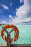 Life belt at the sea. With island blue sky and clouds royalty free stock images