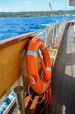 Life belt on small ship. In the sea near Greece royalty free stock image
