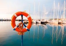Life belt at a yacht harbor Stock Photo