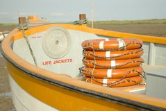 Life belts for boat safety. Life belts or rings in a small ferry boat and a compartment for life jackets to ensure people`s safety royalty free stock photo