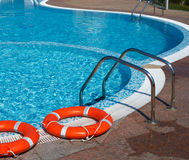 Life-belts and pool Stock Image