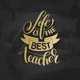 Life is the best teacher gold hand written lettering typography Stock Photo