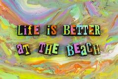 Life better at beach. Positive attitude optimism life is living the beach ocean sea shore enjoyment enjoy letterpress block paint background fun swimming good stock photo