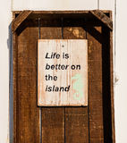 Life is better on the island. The inscription on the wall of one of the houses on the island of Paros, Cyclades, Greece royalty free stock photos