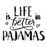 Life is better in pajamas lettering. Hand drawn quote. World Sleep Day card. Black phrase isolated on white background Royalty Free Stock Photos