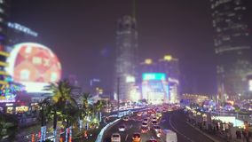 The life of the big city shines with advertising signs: cars and people are moving along the streets. Conceptual. Stylized abstract photo in Shanghai, China stock video footage