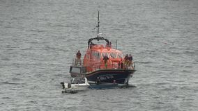 Life boat practicing a rescue off the English coast. Stock Photo