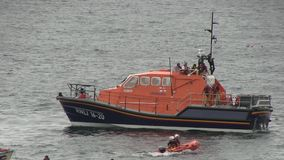 Life boat practicing a rescue off the English coast. Royalty Free Stock Photos