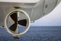 Life Boat Propeller. Close up view of the underside of a suspended life boat with the ocean in the background Stock Image