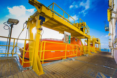 Life boat or survival craft at muster station of oil and gas drilling rig Stock Photo