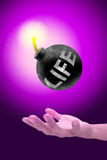Life bomb. Round black  life bomb with a burning fire on hand, spend time concept Stock Photo