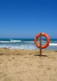 Life bouy. In the empty beach of Crete, Greece Royalty Free Stock Image