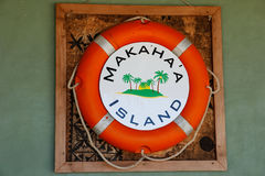 Life bouy on the wall at Makaha`a island near Tongatapu island i Royalty Free Stock Photo