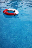 Life buoy. Red life buoy floating in swimming pool Royalty Free Stock Images