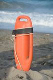 Life buoy. Lifeguard's rescue equipment stands at ready on beach Royalty Free Stock Photos