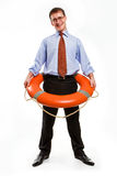 Life buoy. Young handsome businessman holding a life buoy Royalty Free Stock Photos
