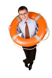 Life buoy. Young handsome businessman holding a life buoy Royalty Free Stock Photography