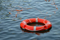 Life buoy. Orange life buoy in water Royalty Free Stock Photos