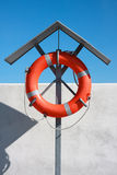 Life buoy. Orange life buoy on the rack at the breakwater ready for help.  Safety equipment Stock Images