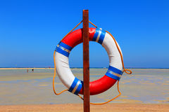 Life buoy. Low tide at the beach. In the foreground life buoy Royalty Free Stock Photo