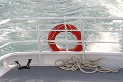 Life Buoy. An Orange Life Buoy on the back of a boat Stock Photos