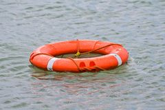 Life buoy. Orange life buoy in water Stock Photos